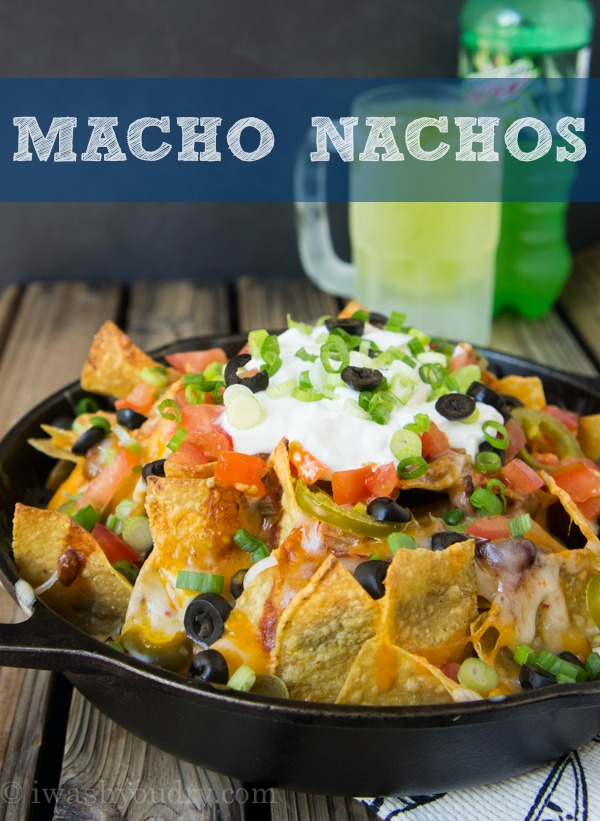 Nachos With Black Olives, Cheese, Corn Chips, Onions, Jalapeno & Sour Cream.